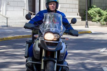 Senator Jones on motorcycle